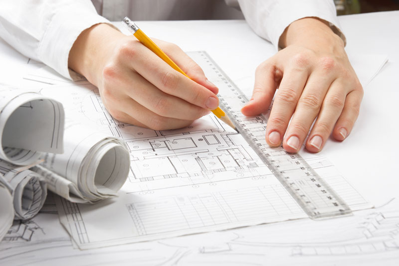 man working on construction plan