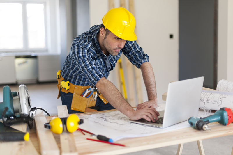 construction man on laptop